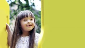 Closeup of young girl smiling on the playground